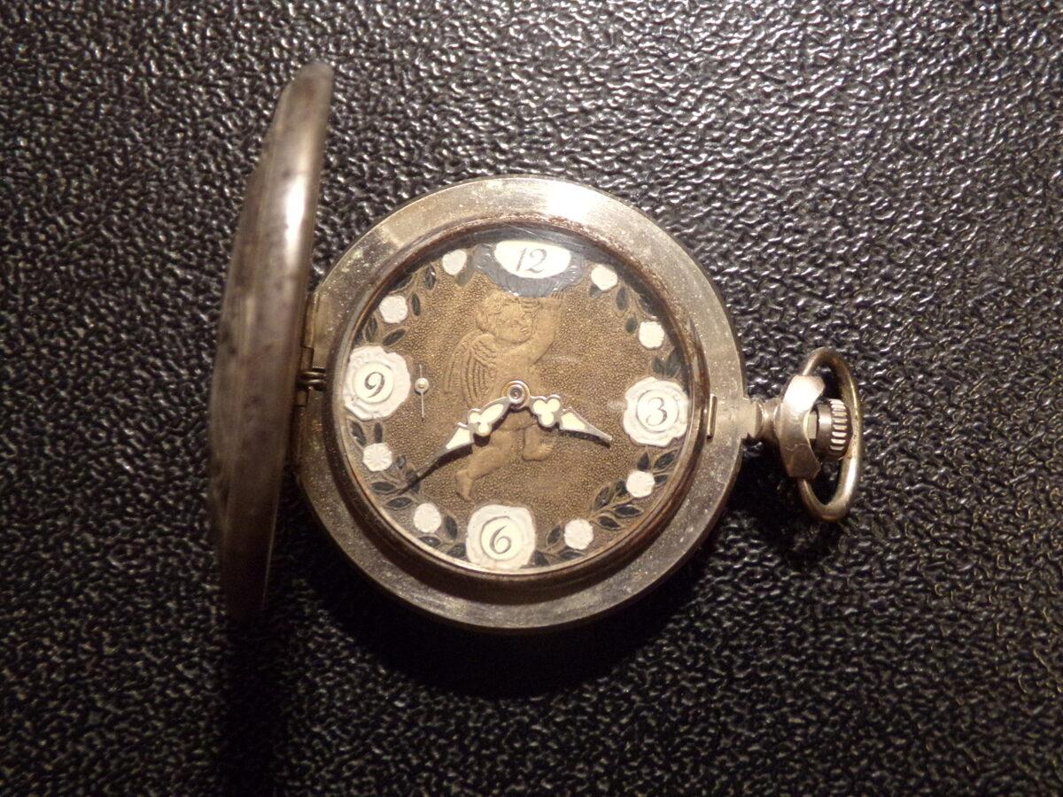 Карманные часы с Амуром. Начало 20 века.