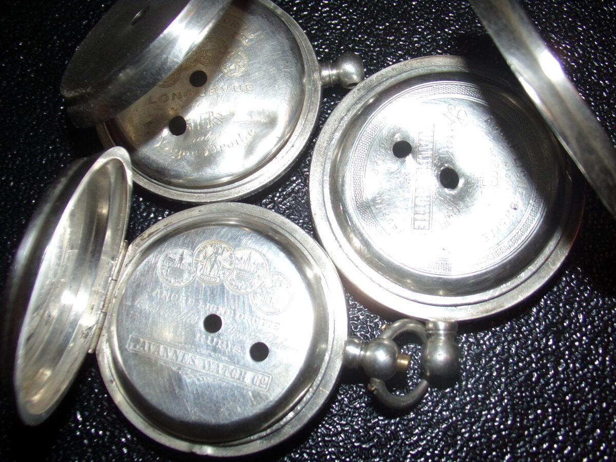 Trīs kabatas pulksteņu korpusi. 20. gs sākums